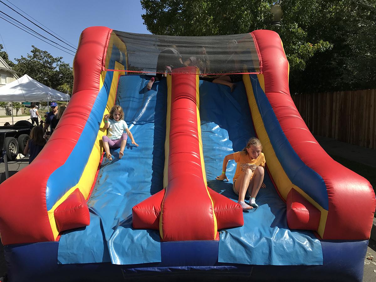 CCCHA kids playing on slide
